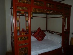 My bed at the Zen Garden Hotel, Lijiang